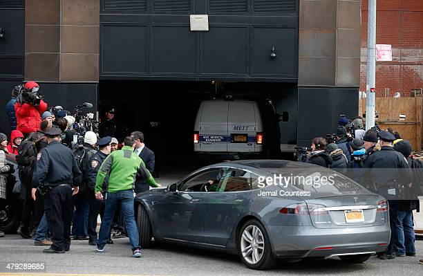 Press clamour for a photo as the medical examiners van transporting the body of Fashion Designer L'Wren Scott prepares to depart the Chelsea...