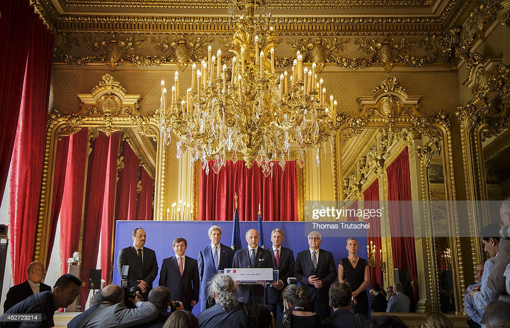 Press conference after a meeting of Foreign Ministers at french foreign ministry. L-R: Qatari Foreign Minister Khaled al-Attiyah, Turkish Foreign Minister Ahmet Davutoglu, U.S. Secretary of State John Kerry, French Foreign Minister Laurent Fabius, British Foreign Secretary Philip Hammond, German Foreign Minister Frank-Walter Steinmeier, and Italian Foreign Minister Federica Mogherini on July 26, 2014 in Paris, France. Several Foreign Ministers attends the meeting in Paris to discuss the situation in the Gaza conflict.