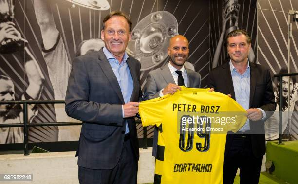 Press conference Borussia Dortmunds new head coach Peter Bosz m with HansJoachim Watzke l and Michael Zorc r at Signal Iduna Park on June 6 2017 in...