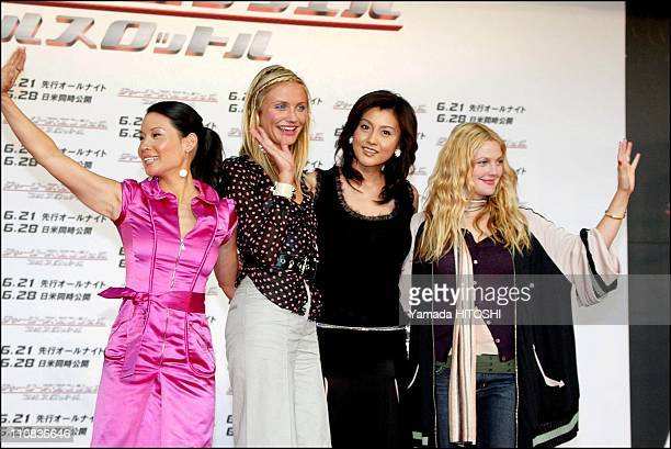 Press Conference Of 'Charlie's Angels Full Throttle' In Tokyo Japan On June 02 2003 Japanese actress Norika Fujiwara poses with Lucy Liu Cameron Diaz...