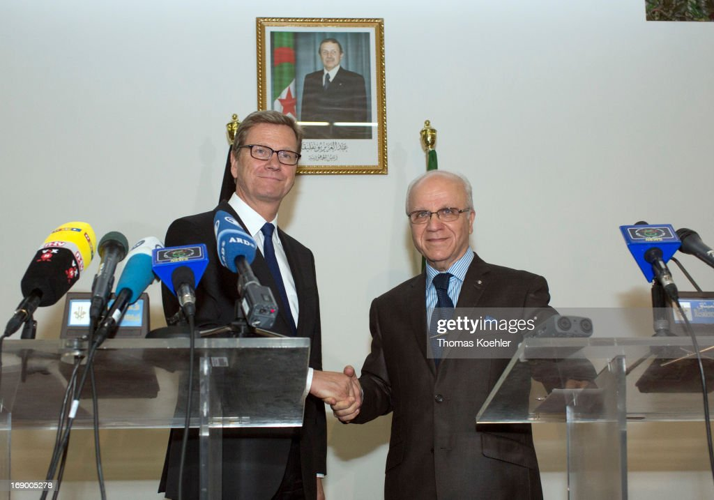 Press conference with German Foreign Minister <a gi-track='captionPersonalityLinkClicked' href=/galleries/search?phrase=Guido+Westerwelle&family=editorial&specificpeople=208748 ng-click='$event.stopPropagation()'>Guido Westerwelle</a> (L) and the Foreign Minister of Algeria, Mourad Medelci, on May 18, 2013 in Algiers, Algeria. The issues topping the agenda are renewed efforts for the Middle East peace process, the crisis in Syria and the Iranian nuclear program.