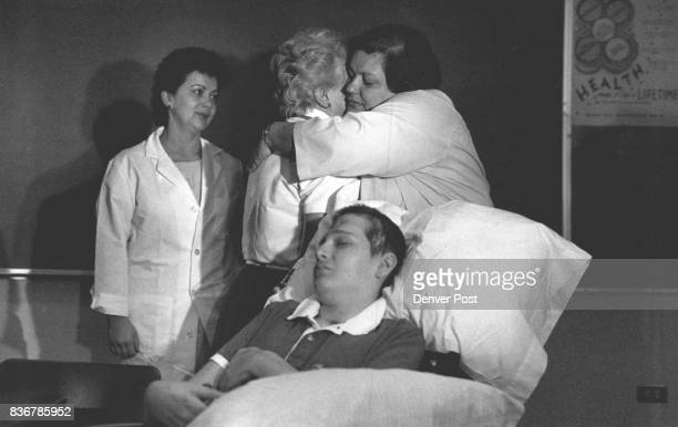 Press Conf/on the Release of Markus Lang from the hospital L to R Vera De Blasis watches on has Mrs Rita Lang the mother gives Joan Lund a Big Hug...