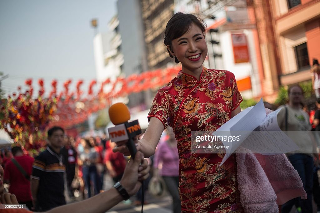 A press member is seen as the participants walk through Chinatown during Chinese New Year celebrations in Bangkok, Thailand on February 8, 2016. The Lunar new year will mark the start of the year of the monkey and will widely celebrated throughout the country where 14 percent of the population is ethnic Chinese.