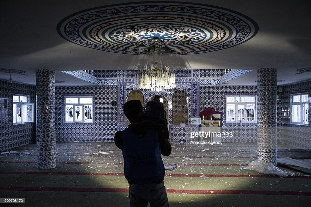 A press member is seen at the damaged Mosque which was damaged by PKK terrorists as Turkish security forces patrol around after counter-terror operation in Cizre finished, on February 12, 2016.