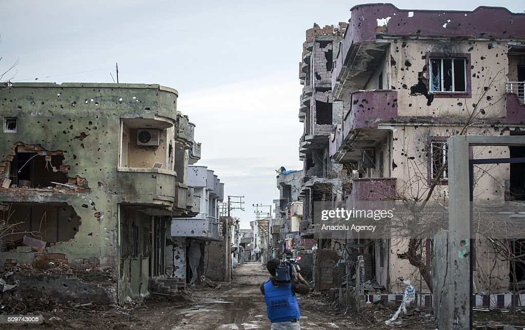 A press member shoots a street where PKK heavily damaged whole neighborhood, after counter-terror operation in Cizre, the southeastern Turkish town that has seen fighting rage between security forces and PKK terrorists finished, on February 12, 2016.