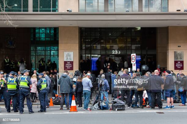Press members and police are seen outside the court during Cardinal George Pell's court hearing at the Melbourne Magistrates Court in Melbourne...