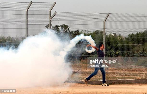 Press members are seen effected by tear gas during a demonstration against Israeli Government's policies and violations over AlAqsa Mosque on October...
