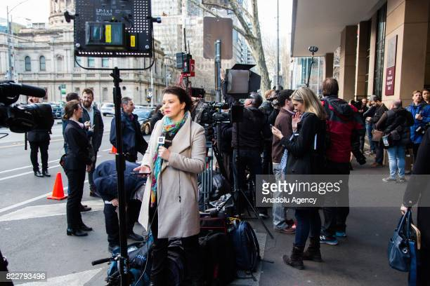 Press members are seen outside the court during Cardinal George Pell's court hearing at the Melbourne Magistrates Court in Melbourne Australia on...