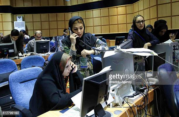 Press members follow the Iranian elections as poll counting continues following the elections held for both parliamentary and the Assembly of Experts...