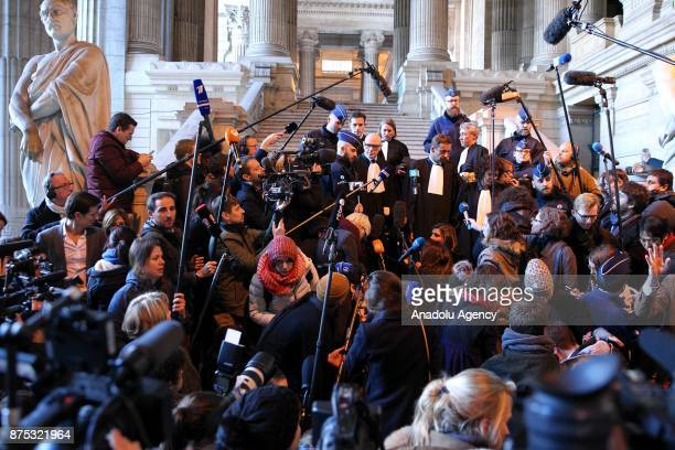 Press members gather for a press conference of ousted Catalan president Carles Puigdemont's lawyer Paul Bekaert at the end of the first hearing in...