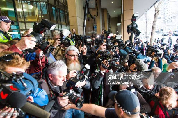 Press members try to get photos of Cardinal George Pell as he arrives for court hearing at the Melbourne Magistrates Court in Melbourne Australia on...