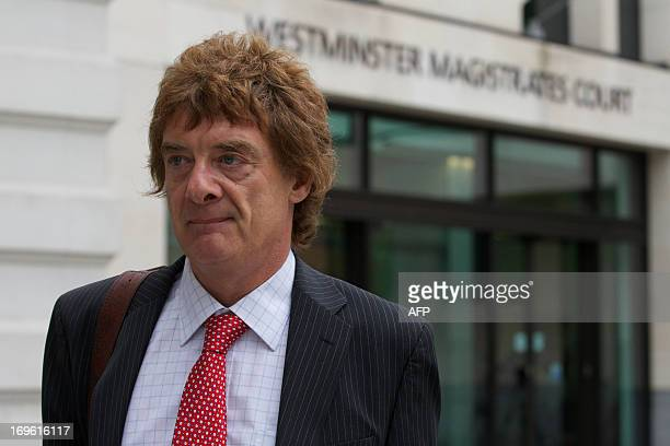 press officer Jonathan Hall leaves Westminster Magistrates Court in central London on May 29 2013 where he and other defendants face charges arising...