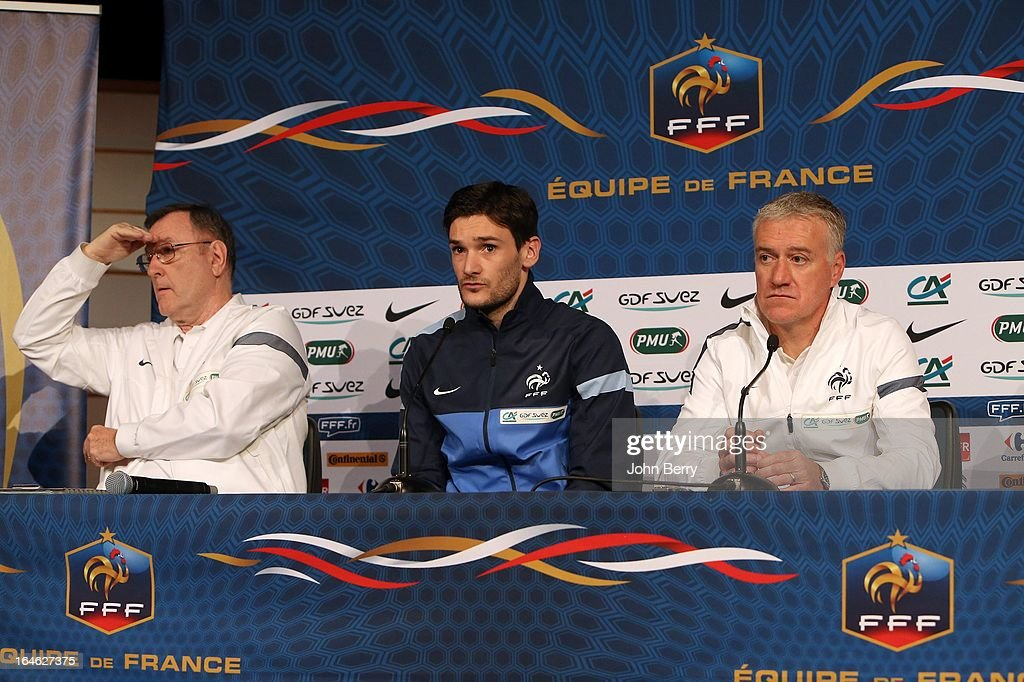 Press officer Philippe Tournon of France, goalkeeper <a gi-track='captionPersonalityLinkClicked' href=/galleries/search?phrase=Hugo+Lloris&family=editorial&specificpeople=2501893 ng-click='$event.stopPropagation()'>Hugo Lloris</a> and head coach <a gi-track='captionPersonalityLinkClicked' href=/galleries/search?phrase=Didier+Deschamps&family=editorial&specificpeople=213607 ng-click='$event.stopPropagation()'>Didier Deschamps</a> answer questions from the media during a press conference prior to the FIFA World Cup 2014 qualifier between France and Spain at the Stade de France on March 25, 2013 in Saint-Denis near Paris, France.