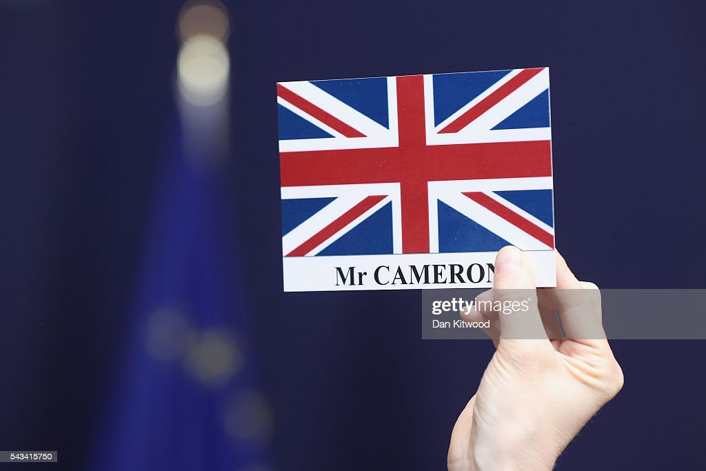 A press officer removes the place name of David Cameron after the group family photo with the European Council during a European Council Meeting at the Council of the European Union on June 28, 2016 in Brussels, Belgium. British Prime Minister David Cameron will hold talks with other EU leaders in what will likely be his final scheduled meeting with the full European Council before he stands down as Prime Minister. The meetings come at a time of economic and political uncertainty following the referendum result last week which saw the UK vote to leave the European Union.