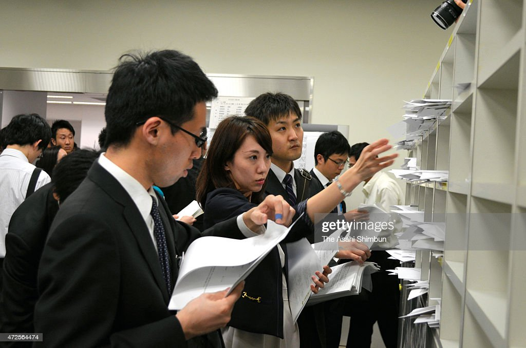 Press officers of companies post the financial result documents at Kabuto Club press club in the Tokyo Stock Exchange on May 8 2015 in Tokyo Japan