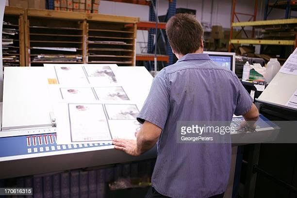 Press Operator Checking Color Accuracy