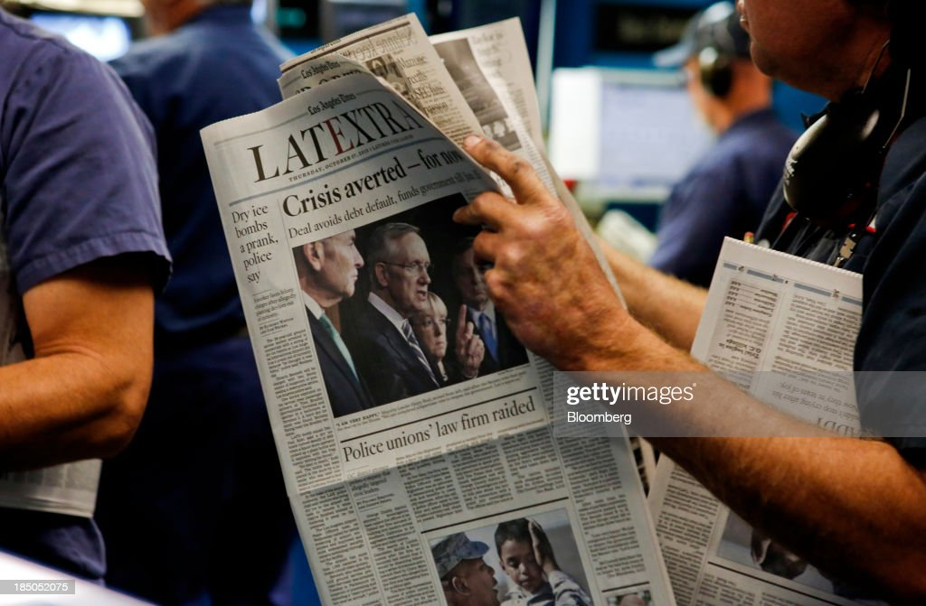 Press operators check the print quality of the Los Angeles Times LATEXTRA edition newspaper at the Olympic Press facility in Los Angeles, California, U.S, on Wednesday, Oct. 16, 2013. Congress ended the 16-day government shutdown, raising the U.S. debt limit after the leaders of the Senate reached a bipartisan agreement to end the nation's fiscal impasse. Photographer: Patrick T. Fallon/Bloomberg via Getty Images