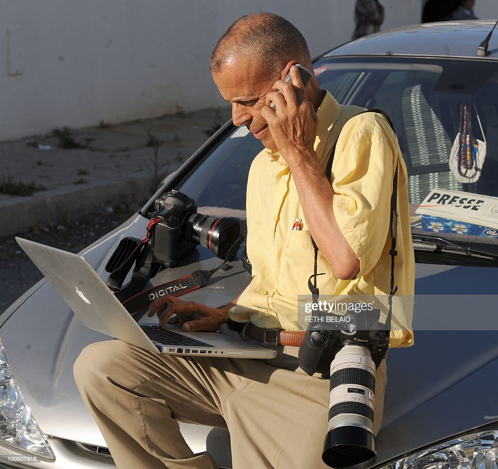 Press photographer Mohamed Hammi sends pictures for his agency on May 25, 2010 in Tunis.
