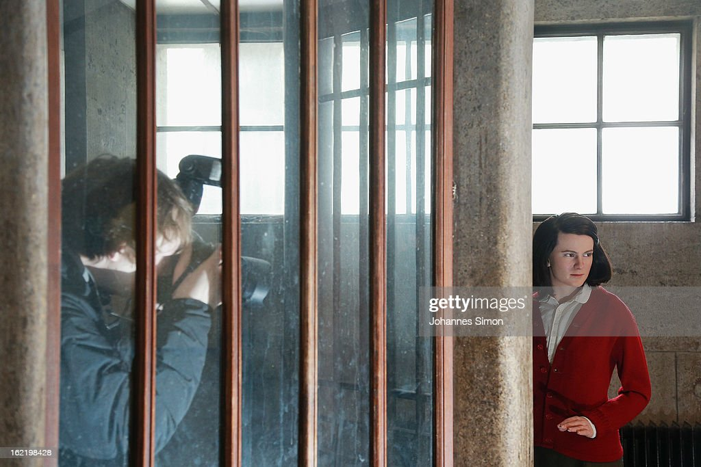 A press photographer takes a picture of a Madame Tussauds wax effigy of Sophie Scholl, one of the most famous members of the German World War II anti-Nazi resistance movement, The White Rose is displayed near to one of the backside entrance doors at Ludwig Maximilian University on February 20, 2013 in Munich, Germany. Sophie Scholl, whose active opposition to the Nazis led to her execution 70 years ago, was a student at Munich University, where she printed and distributed anti-Nazi leaflets. To commemorate the day of her death, the wax effigy was moved for a photo call to Munich from Madame Tussauds wax cabinet at Berlin.