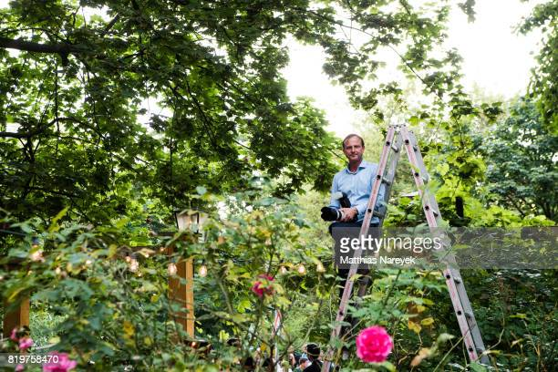 A press photographer waits for the arrival of Duke and Duchess of Cambridge at a reception with creatives at 'Claerchens Ballhaus' the last original...