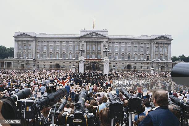 Press photographers and crowds of wellwishers outside Buckingham Palace on the day of Prince Charles wedding to Lady Diana Spencer London 29th July...