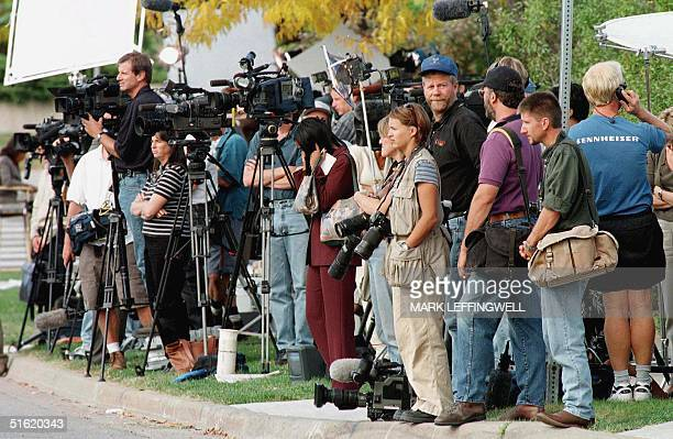 Press photographers and videographers watch the entrance of the Boulder County Justice Center waiting for word from the Grand Jury on the JonBenet...