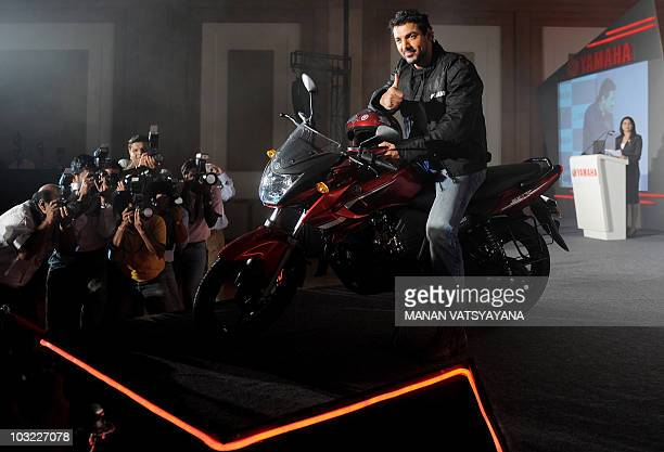 Press photographers capture Indian Bollywood actor John Abraham posing on a newlyunveiled Yamaha motorcycle at the launch in Greater Noida around 50...