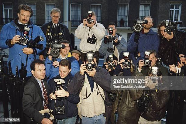 Press photographers doorstepping British Conservative MP Michael Heseltine London circa 1990