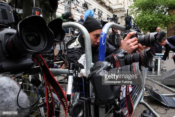 Press photographers set up their remote cameras as they wait for a glimpse of British Prime Minister Gordon Brown who arrived back at 10 Downing...