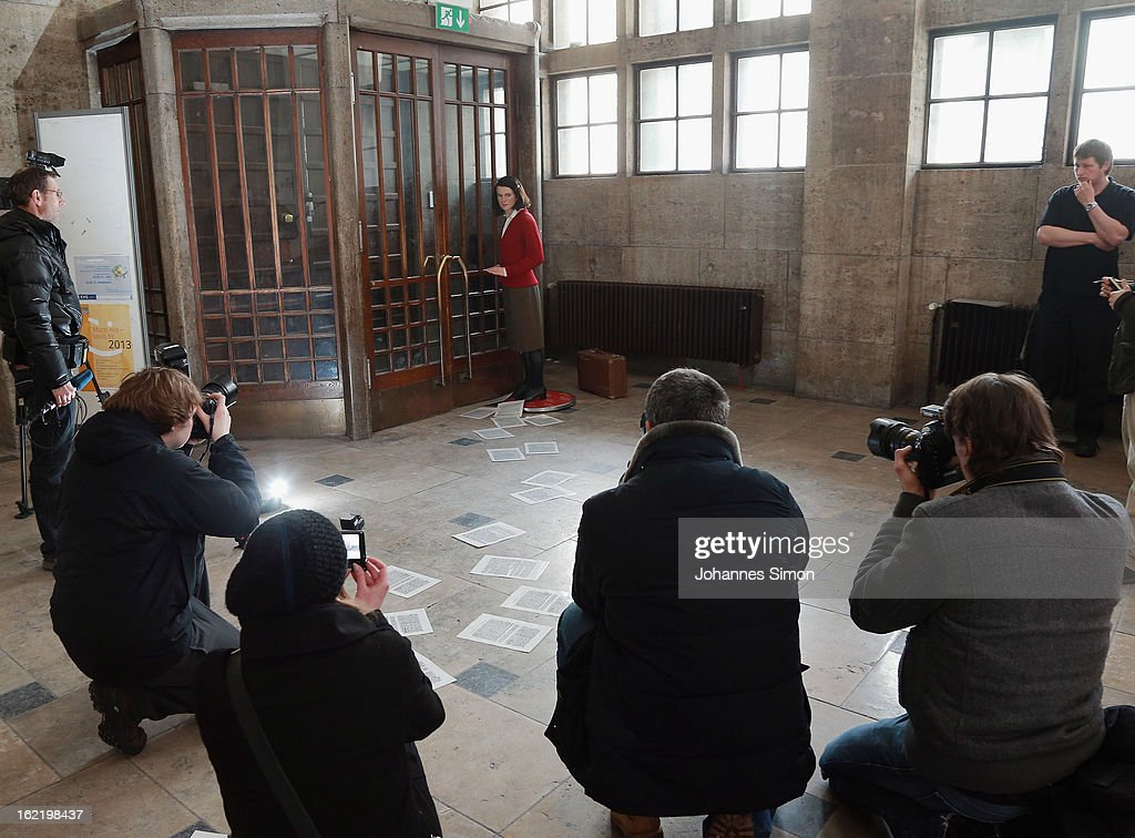 Press photographers take pictures of a Madame Tussauds wax effigy of Sophie Scholl, one of the most famous members of the German World War II anti-Nazi resistance movement, The White Rose is displayed near to one of the backside entrance doors at Ludwig Maximilian University on February 20, 2013 in Munich, Germany. Sophie Scholl, whose active opposition to the Nazis led to her execution 70 years ago, was a student at Munich University, where she printed and distributed anti-Nazi leaflets. To commemorate the day of her death, the wax effigy was moved for a photo call to Munich from Madame Tussauds wax cabinet at Berlin.