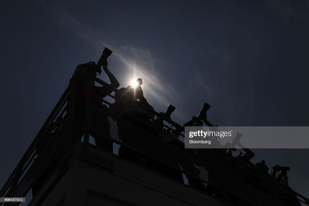 Press photographers work on a balcony during the 53rd International Paris Air Show at Le Bourget, in Paris, France, on Tuesday, June 20, 2017. The show is the world's largest aviation and space industry exhibition and runs from June 19-25. Photographer: Chris Ratcliffe/Bloomberg via Getty Images