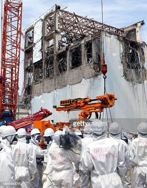 Press reporters attend a press tour to Fukushima Daiichi Nuclear Power Plant where reactor decommissioning work continues on May 26 2012 in Okuma...