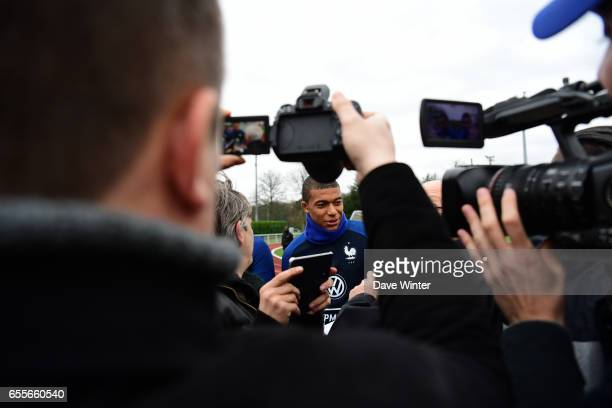 A press scrum around Kylian Mbappe of France who has been called up for the first time during the trainig session of the soccer french national team...