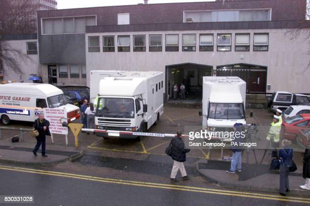 Press surround security vehicles at Southend magistrates court as the thirteen suspected hijackers arrive for their hearing into the Afghan Ariana...
