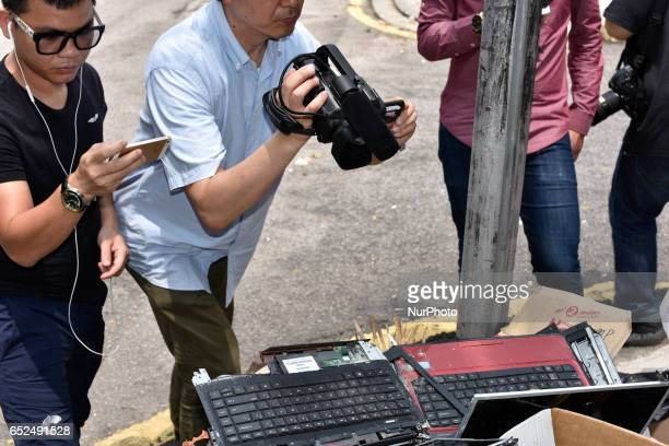 Press takes picture and record video of discarded two damaged laptops and one desktop pc in front of the North Korean Embassy on March 12 2017 in...