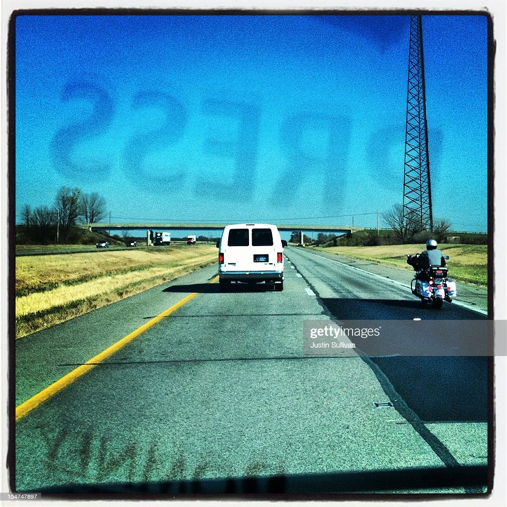 A press van in the motorcade of Republican presidential candidate, former Massachusetts Gov. Mitt Romney drives down a highway October 25, 2012 in Jeffersonville, Ohio. Mitt Romney is campaigning in Ohio with less than two weeks to go before the election.