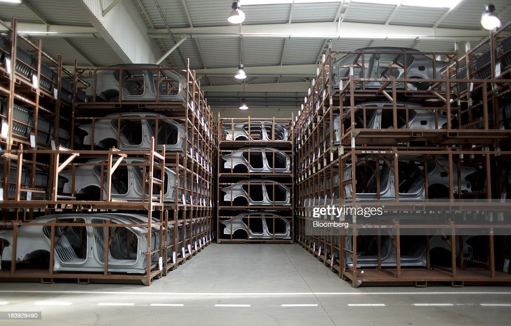 Pressed automobile body parts sit in storage at the Skoda Autos AS plant in Mlada Boleslav, Czech Republic, on Friday, March 15, 2013. VW, which also owns the Porsche luxury-auto brand as well as the Skoda and Seat volume marques, will build at least 10 plants globally, including seven in China, Martin Winterkornm chief executive officer of Volkswagen AG, said. Photographer: Martin Divisek/Bloomberg via Getty Images