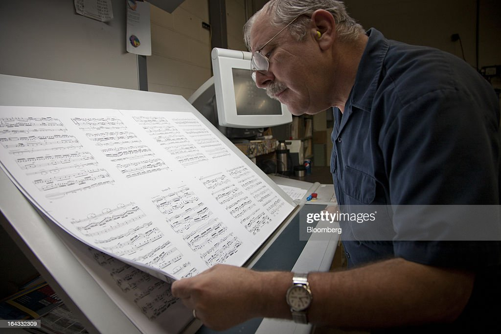 Pressman Kendal Harvey inspects the quality of printing during a print run of sheet music at the Hal Leonard Corp. printing facility in Winona, Minnesota, U.S., on Friday, March 22, 2013. Hal Leonard is the world's largest print music publisher, distributing more than 200,000 titles to over 65 countries. Photographer: Ariana Lindquist/Bloomberg via Getty Images