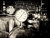 Steam powered traction engine boiler pressure gauge, black and white processed, sepia