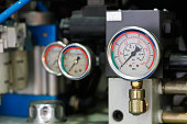 Industrial equipment with pressure gauge meters. Selective focus