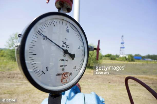 A pressure gauge sits on pipework above a gas well operated by DK Ukrgazvydobuvannya a unit of NAK Naftogaz Ukrainy in Poltava Ukraine on Friday July...