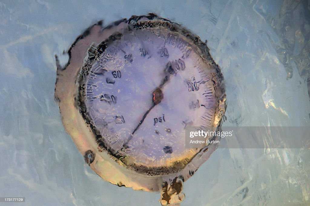 A pressure guage is encased in ice at Minus5 Ice Bar during a media preview on July 9, 2013 in New York City. The bar, which opened yesterday, is built from 90 tons of ice, kept at 23 degrees Fahrenheit, or minus 5 degrees Celsius, and can hold 55 people.