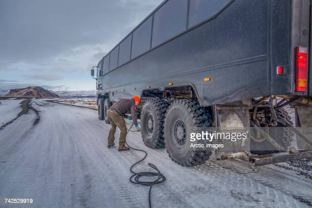 Pressure of the tires being checked to travel over rough terrain in the Thjorsardalur valley, Thorsmork, Iceland.