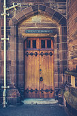 An Old Wooden Door At A College Of A Prestigious University Or School
