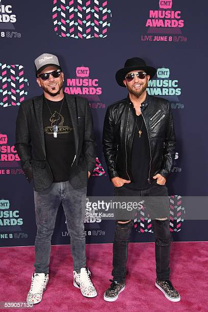 Preston Brust and Chris Lucas from musical duo LoCash attend the 2016 CMT Music awards at the Bridgestone Arena on June 8 2016 in Nashville Tennessee