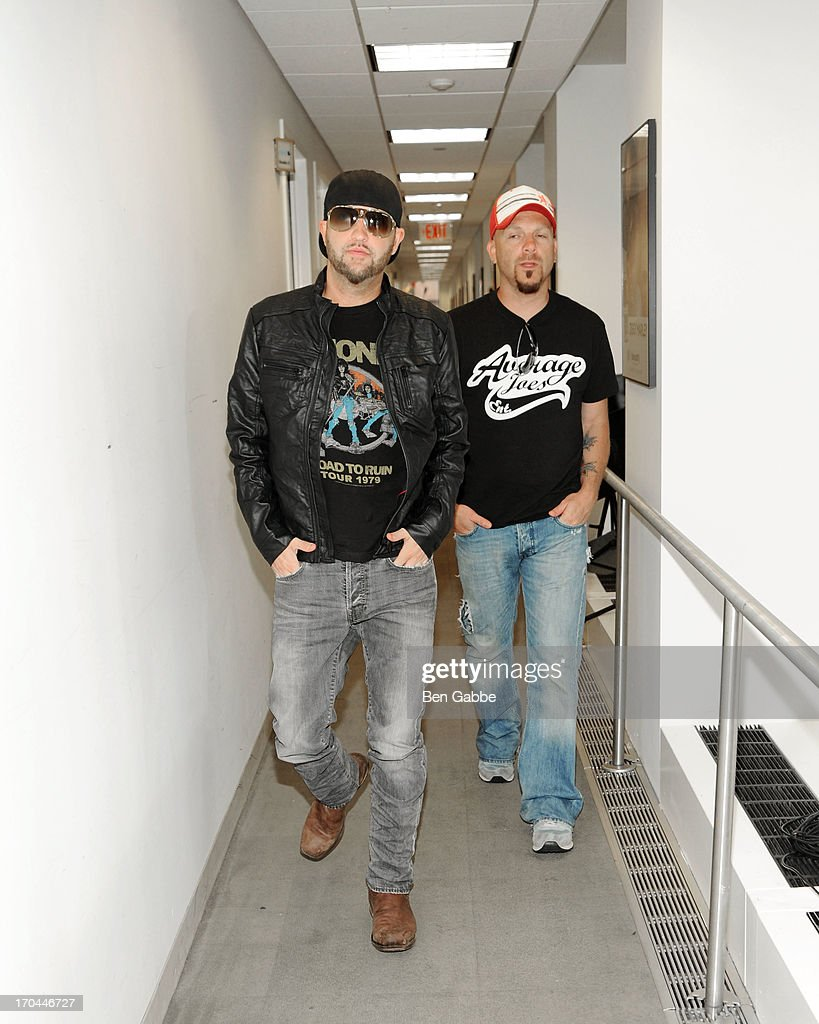 Preston Brust (L) and Chris Lucas of Locash Cowboys visit the SiriusXM Studios on June 13, 2013 in New York City.
