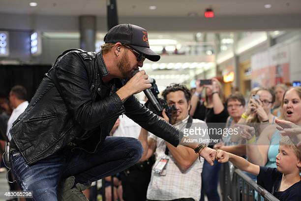 Preston Brust of the band LoCash performs during a performance at Mall of America on Aug 5 2015 in Bloomington Minnesota