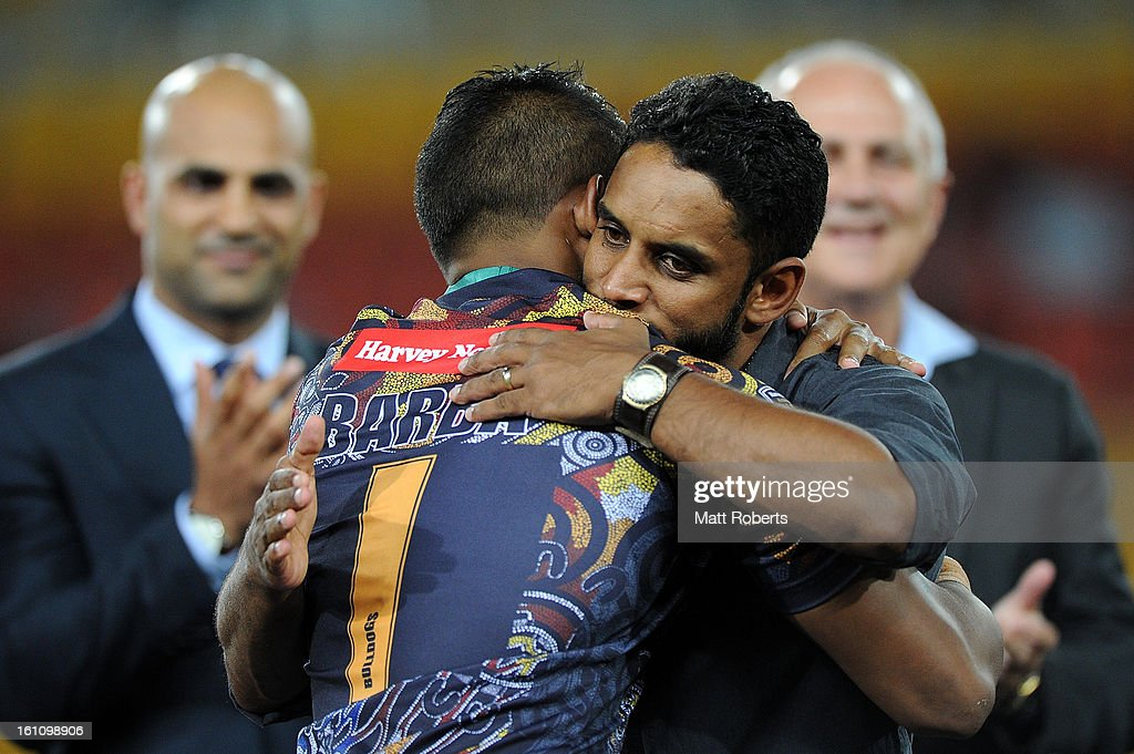 <a gi-track='captionPersonalityLinkClicked' href=/galleries/search?phrase=Preston+Campbell&family=editorial&specificpeople=218064 ng-click='$event.stopPropagation()'>Preston Campbell</a> hugs Ben Barba of the the Indigenous All Stars after he received the man of the match medal after the NRL All Stars Game between the Indigenous All Stars and the NRL All Stars at Suncorp Stadium on February 9, 2013 in Brisbane, Australia.