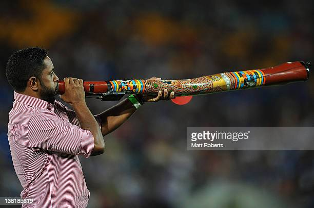 Preston Campbell plays the didgeridoo before the match between the Indigenous All Stars and the NRL All Stars at Skilled Park on February 4 2012 in...