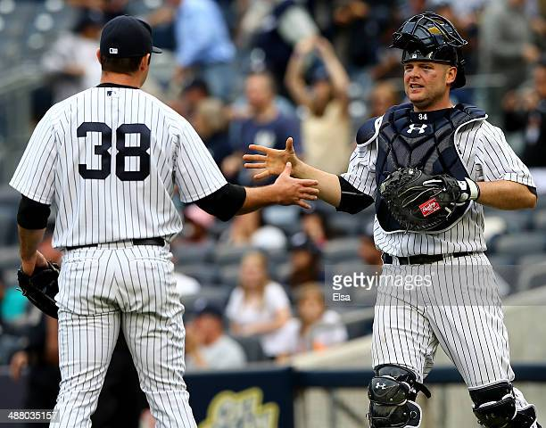 Preston Claiborne and Brian McCann of the New York Yankees celebrate the win over the Tampa Bay Rays on May 3 2014 at Yankee Stadium in the Bronx...